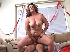 Redhead mature BBW with big tits licked by man
